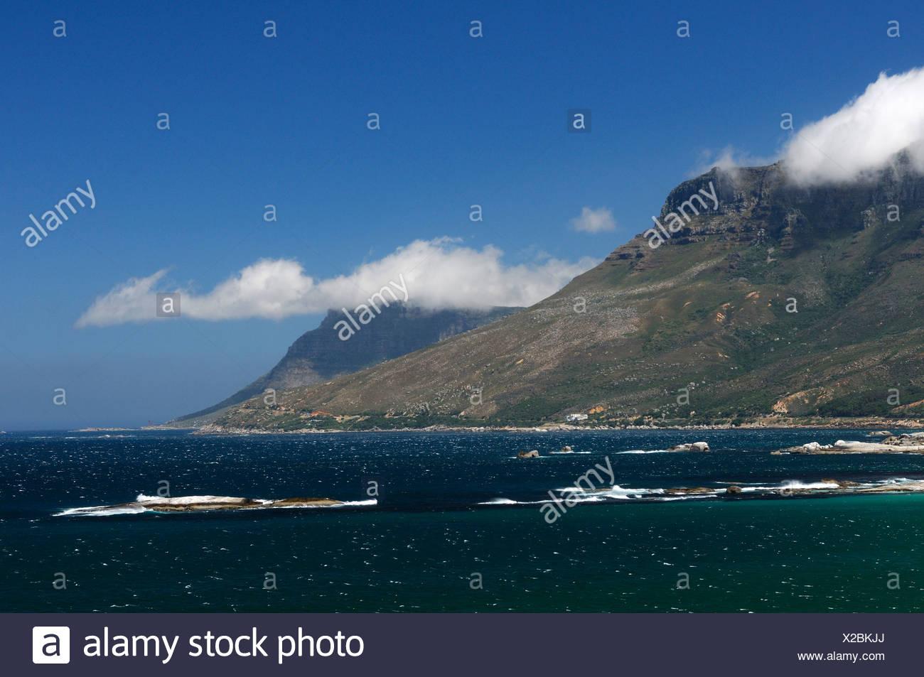 Twelve Apostles Mountains Camps Bay Cape Peninsula Western Cape South Africa fog clouds shore coast sea ocean houses scenery - Stock Image