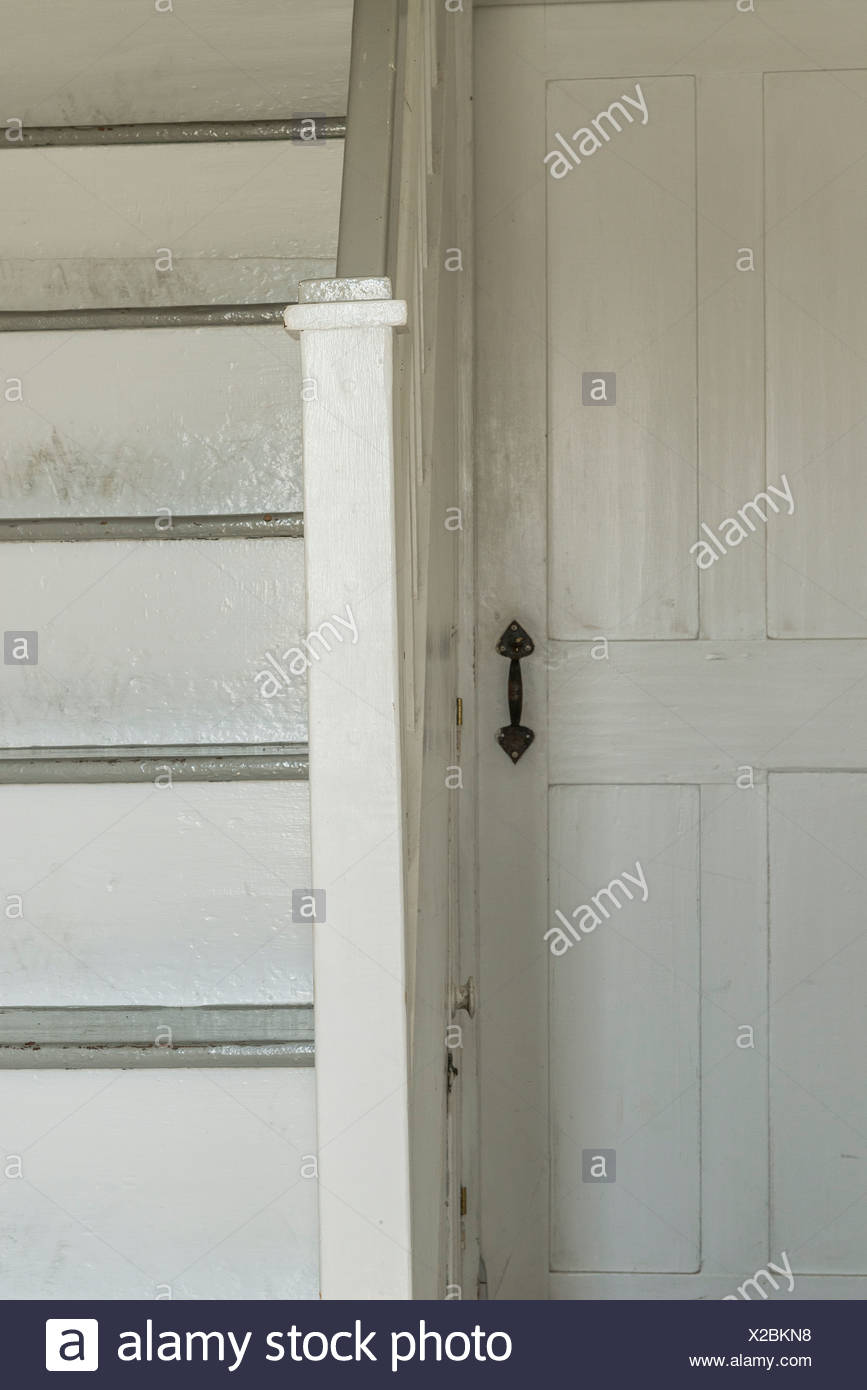 Door and stair detail in old rural home. - Stock Image