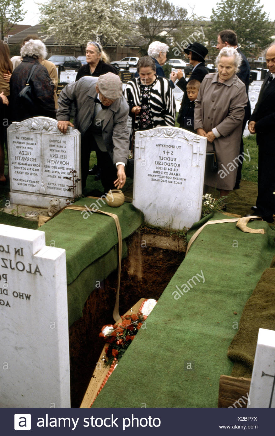 Burial scene in church cemetery - Stock Image