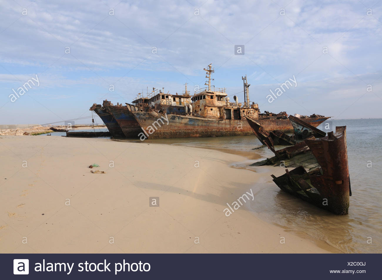 Mauritania,Nouadhibou,Cap Blanc,coast,ship wrecks,stranded,ships,ship cemetery,West Africa,Africa,old,the Atlantic,freighters,sea,navigation,hazy,water,rusts,water,wreck,environmental pollution, - Stock Image