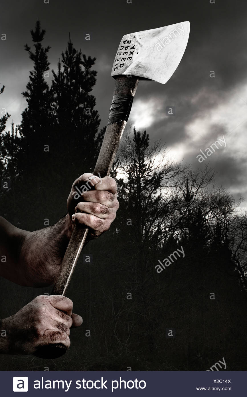 Hands holding an axe during traditional rural sport training, Basque
