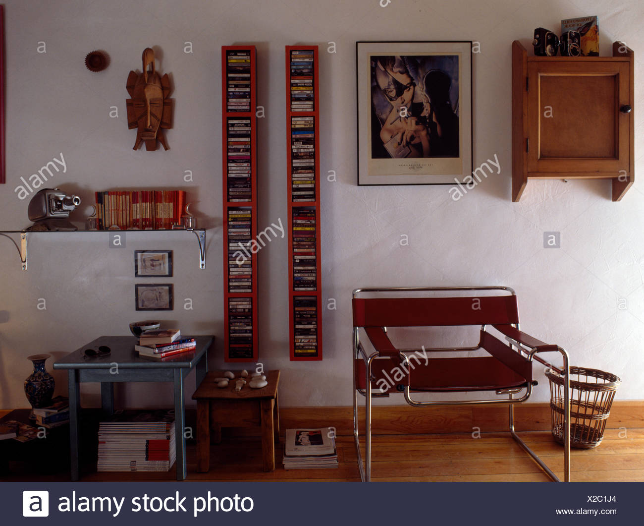 Marcel Breuer chair in early nineties living room with cds in vertical racks on the wall - Stock Image