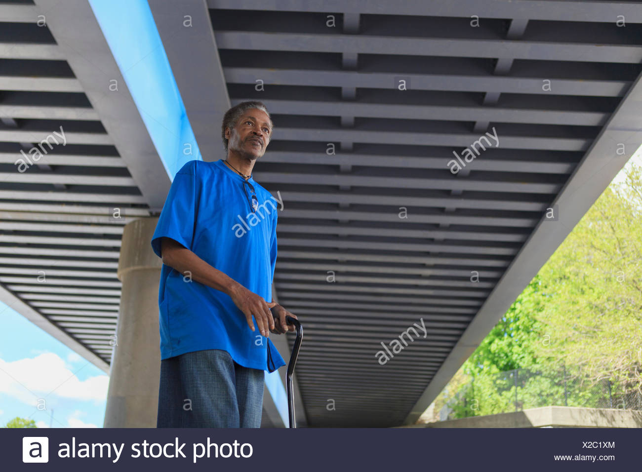 Man with Traumatic Brain Injury taking a walk in his neighborhood - Stock Image
