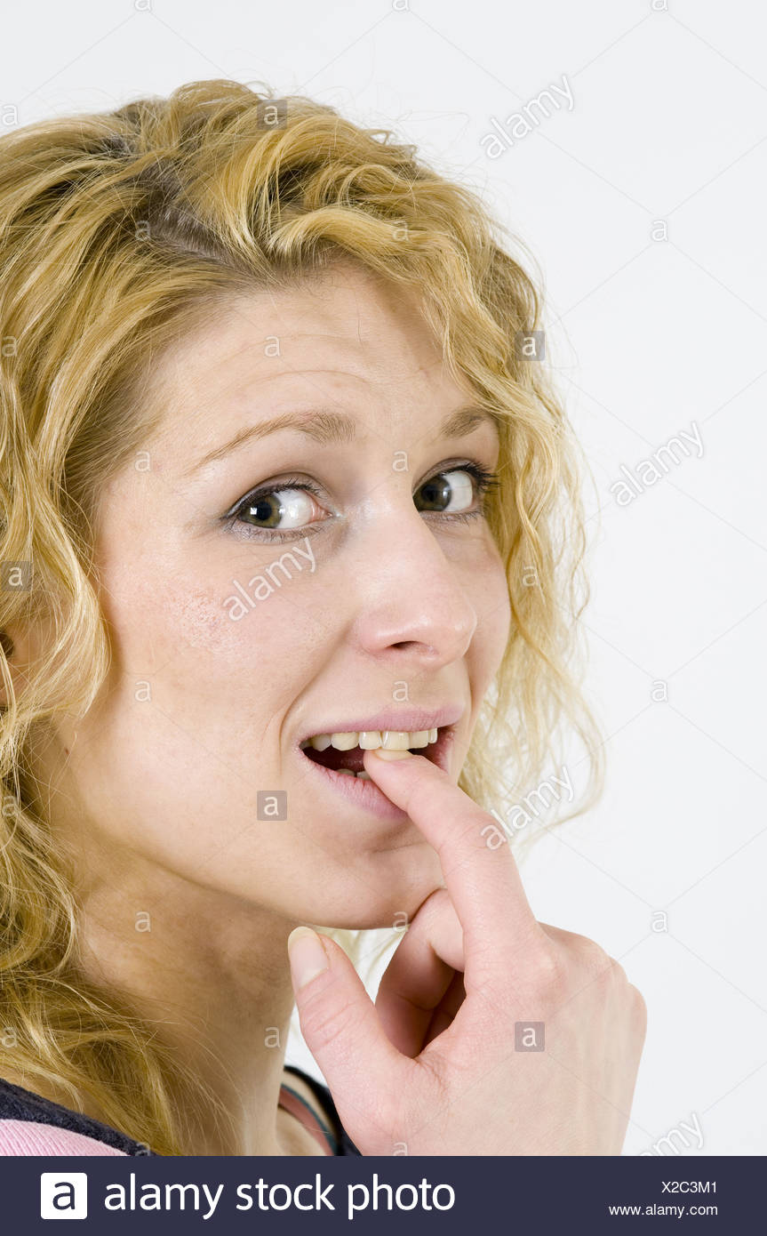 finger at the teeth - Stock Image