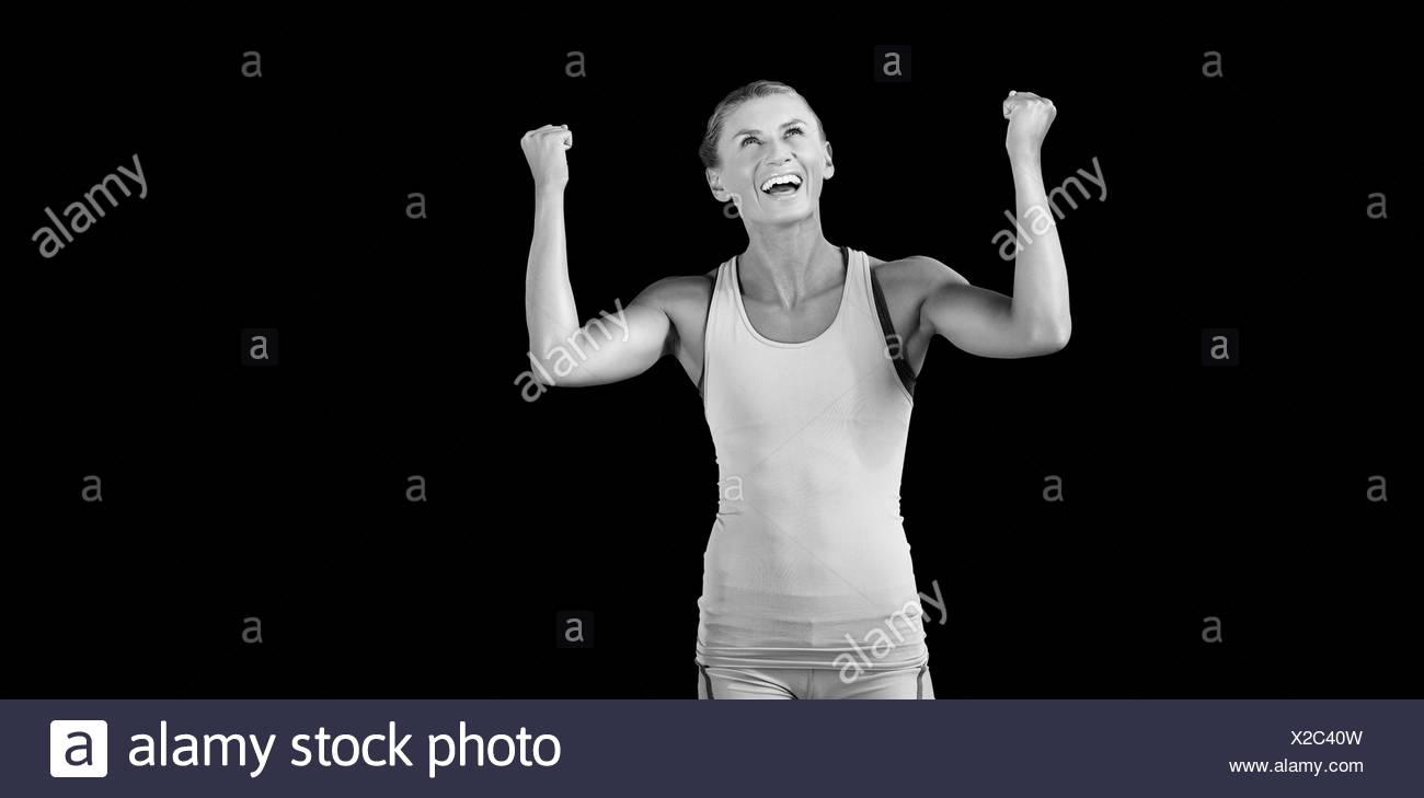 Athletic woman with arms up - Stock Image
