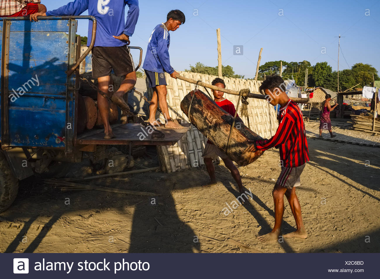 Porters on the banks of the Ayeyarwady River - Stock Image