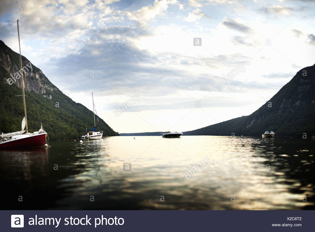 USA Two boats yacht and motorboat moored on calm lake - Stock Image