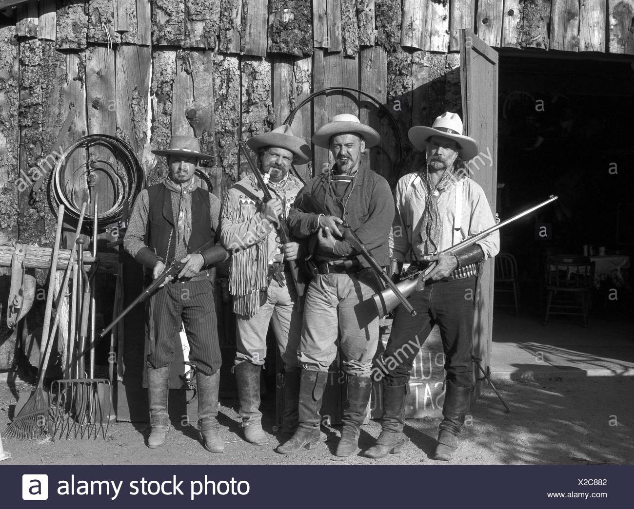Cowboys with guns - Stock Image