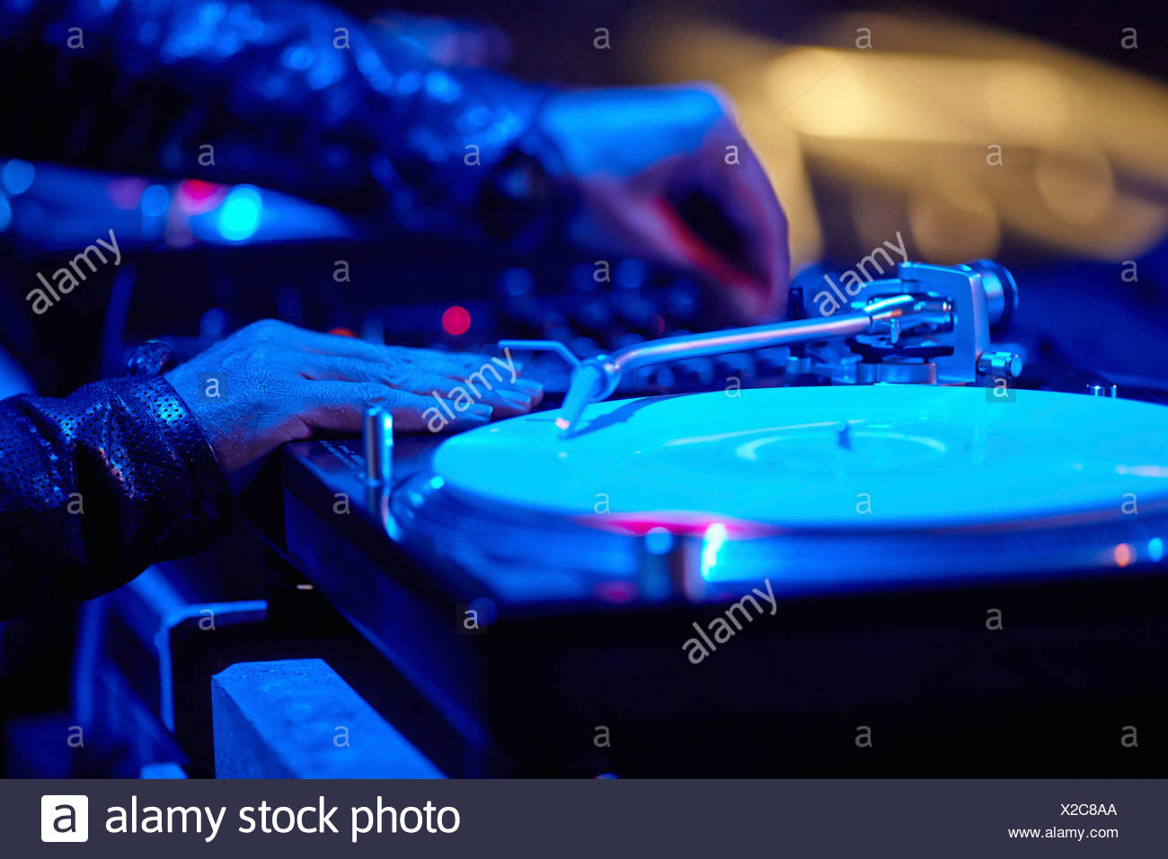 DJ at the turntables, Mayday 2013 techno festival in the Westfalenhalle Dortmund, Dortmund, Ruhr district - Stock Image