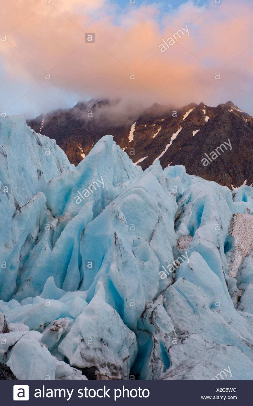Close up of Raven Glacier with evening light hitting clouds in the background, Chugach State Park, Southcentral Alaska, Autumn Stock Photo