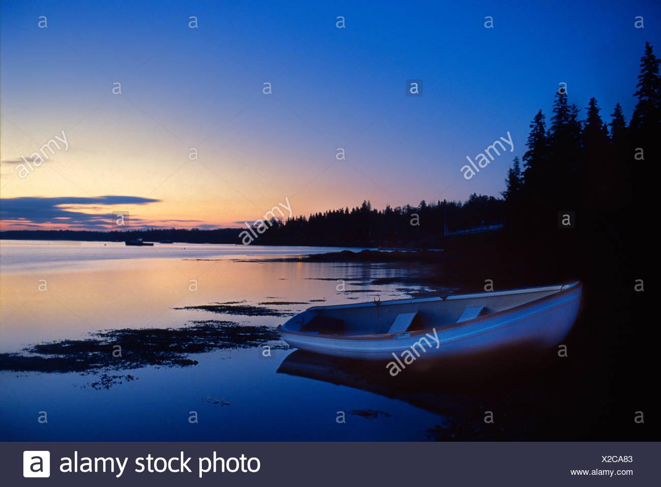 Tranquil rowboat at dusk, Maine - Stock Image