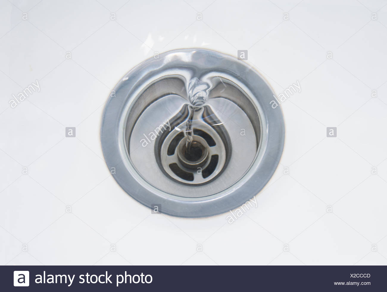 Close up of sink with draining water - Stock Image