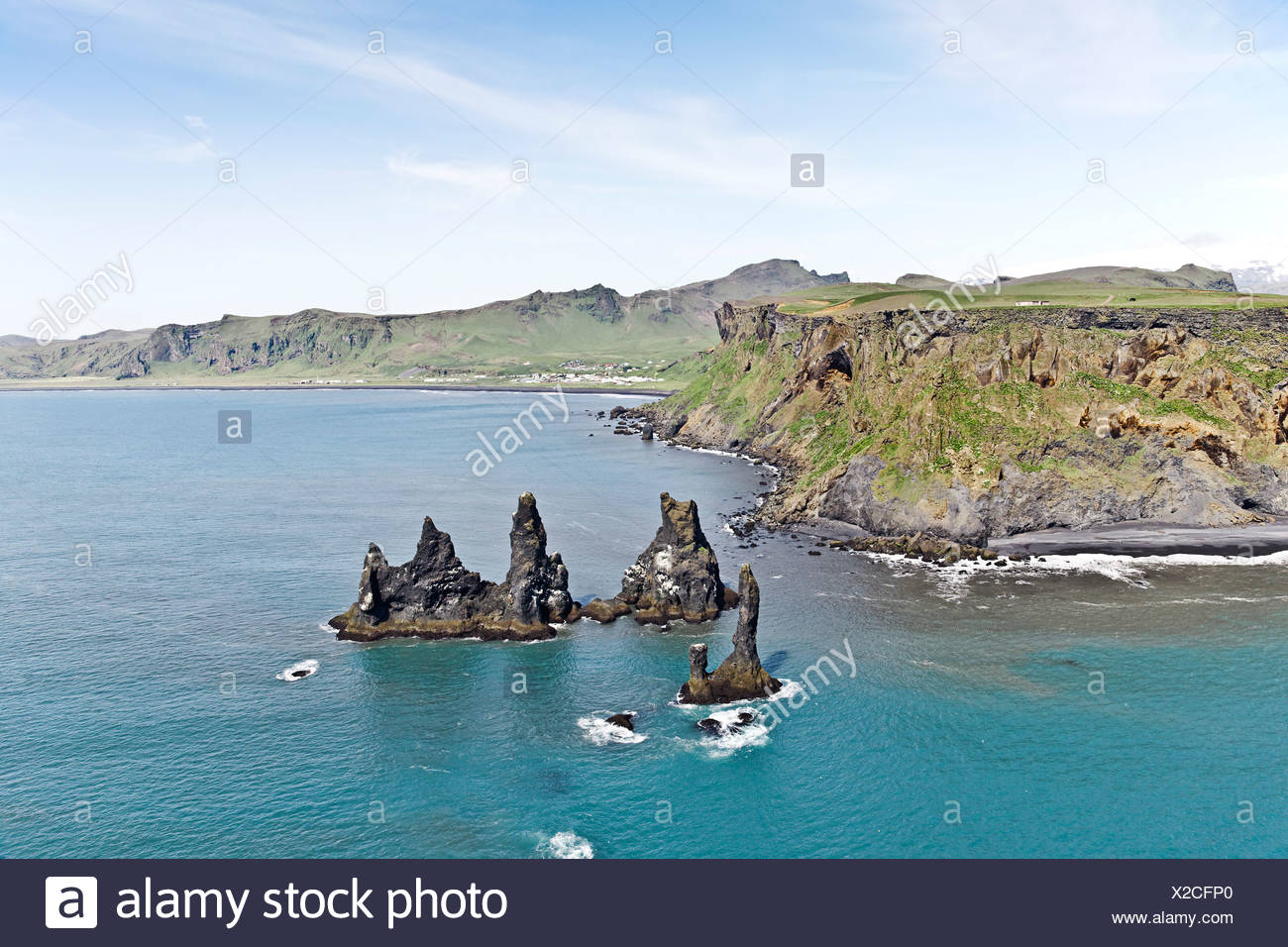Aerial view, the three Skessudrangar rock spires, Skessudrangar, Landdrangar and Langhamrar off the southern coast of Iceland - Stock Image