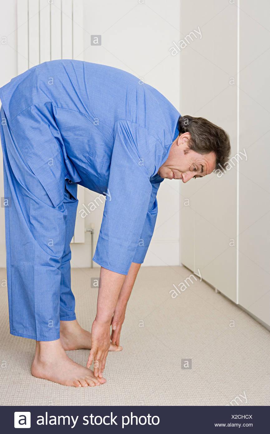 Man stretching - Stock Image