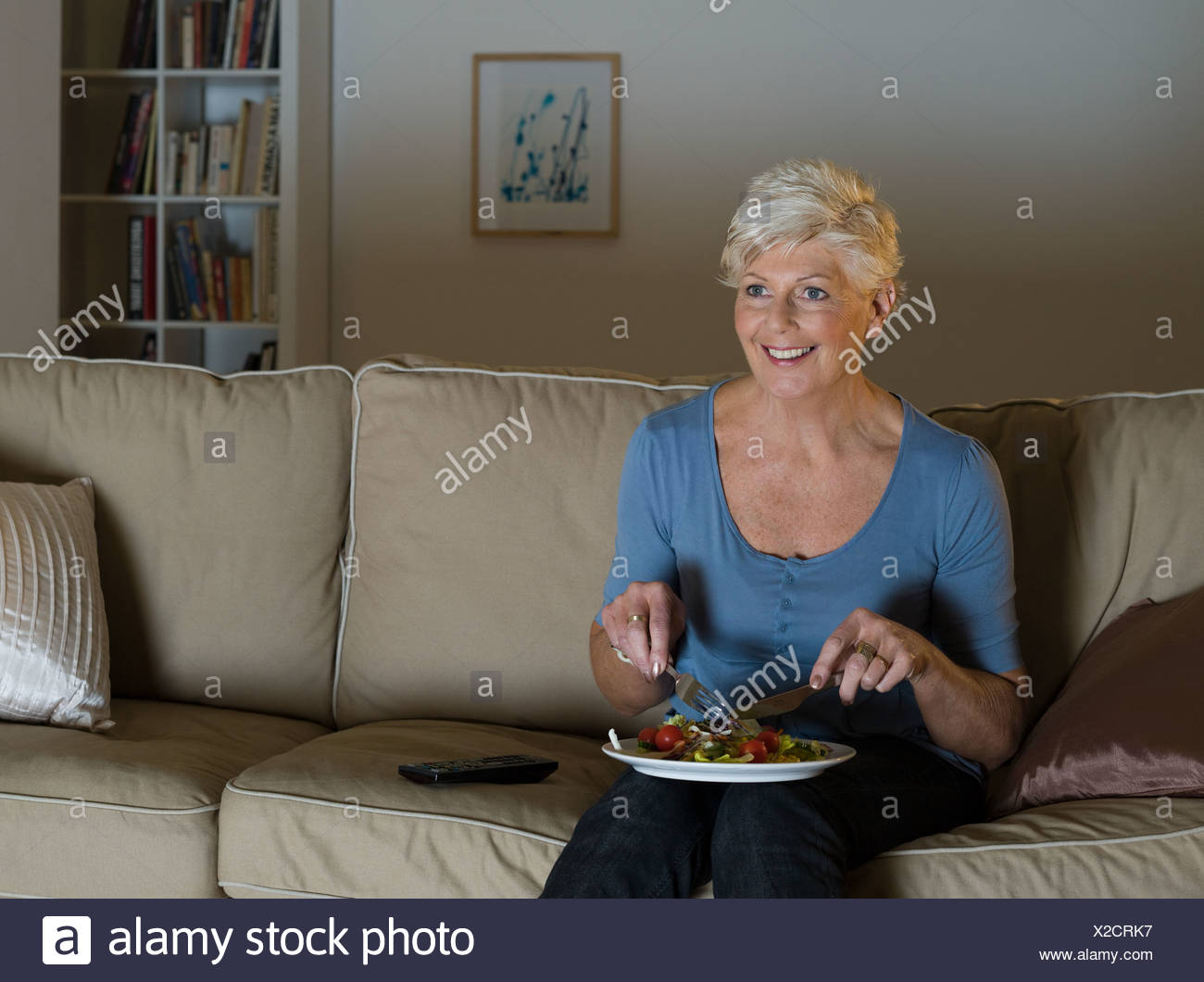 A senior woman having a tv dinner - Stock Image