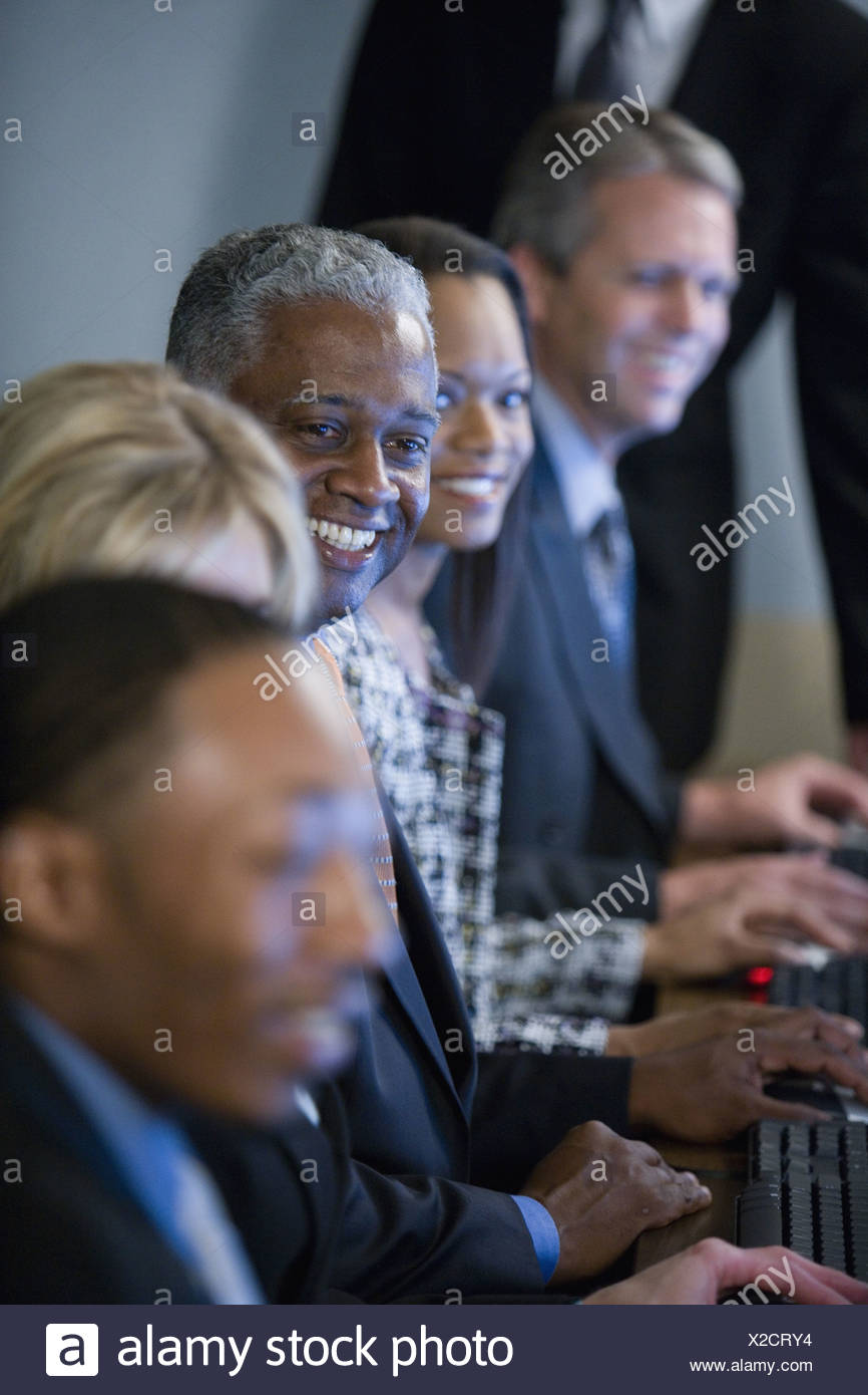 Business colleagues at a computer training seminar - Stock Image