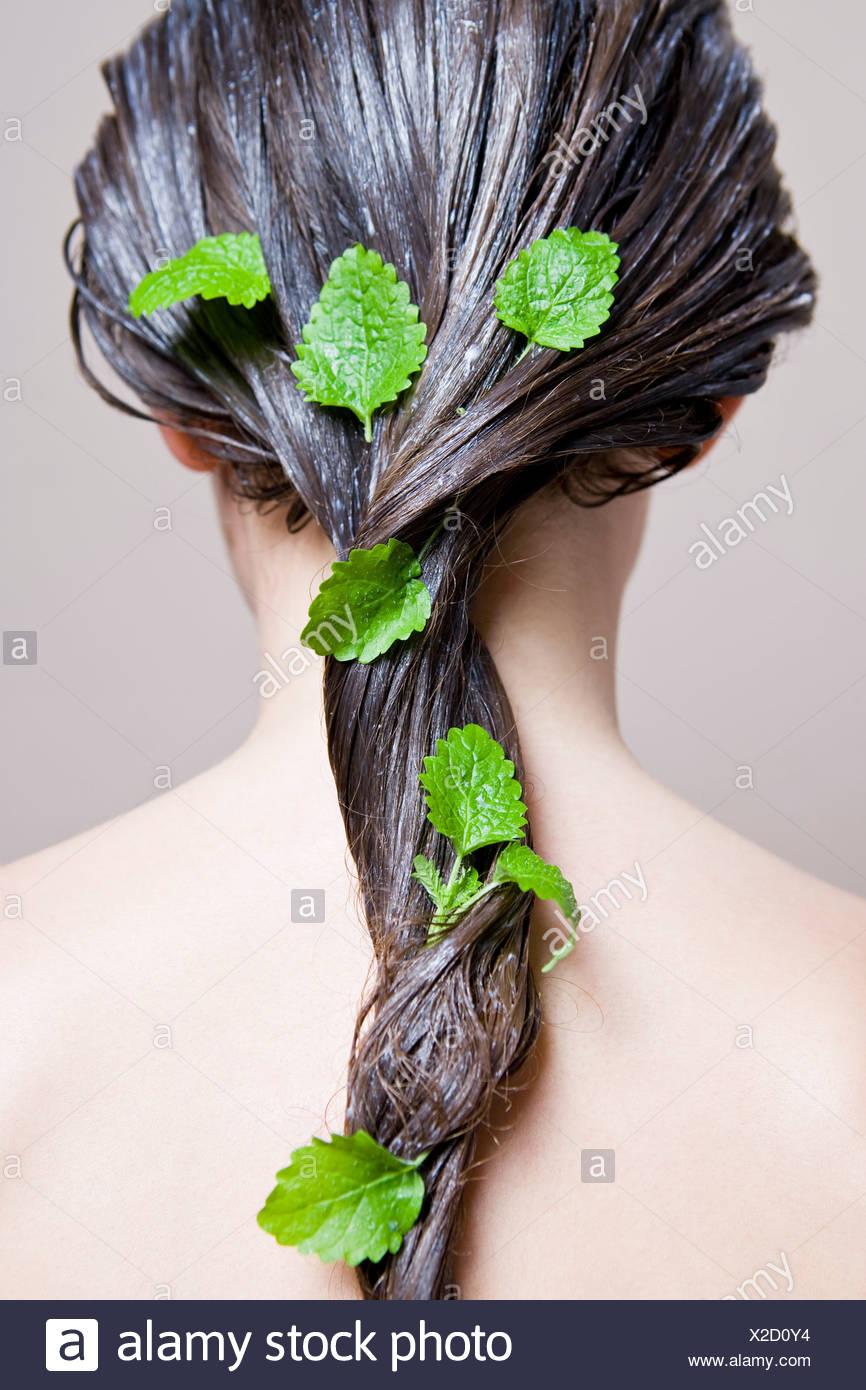 woman with lemon balm hair mask - Stock Image