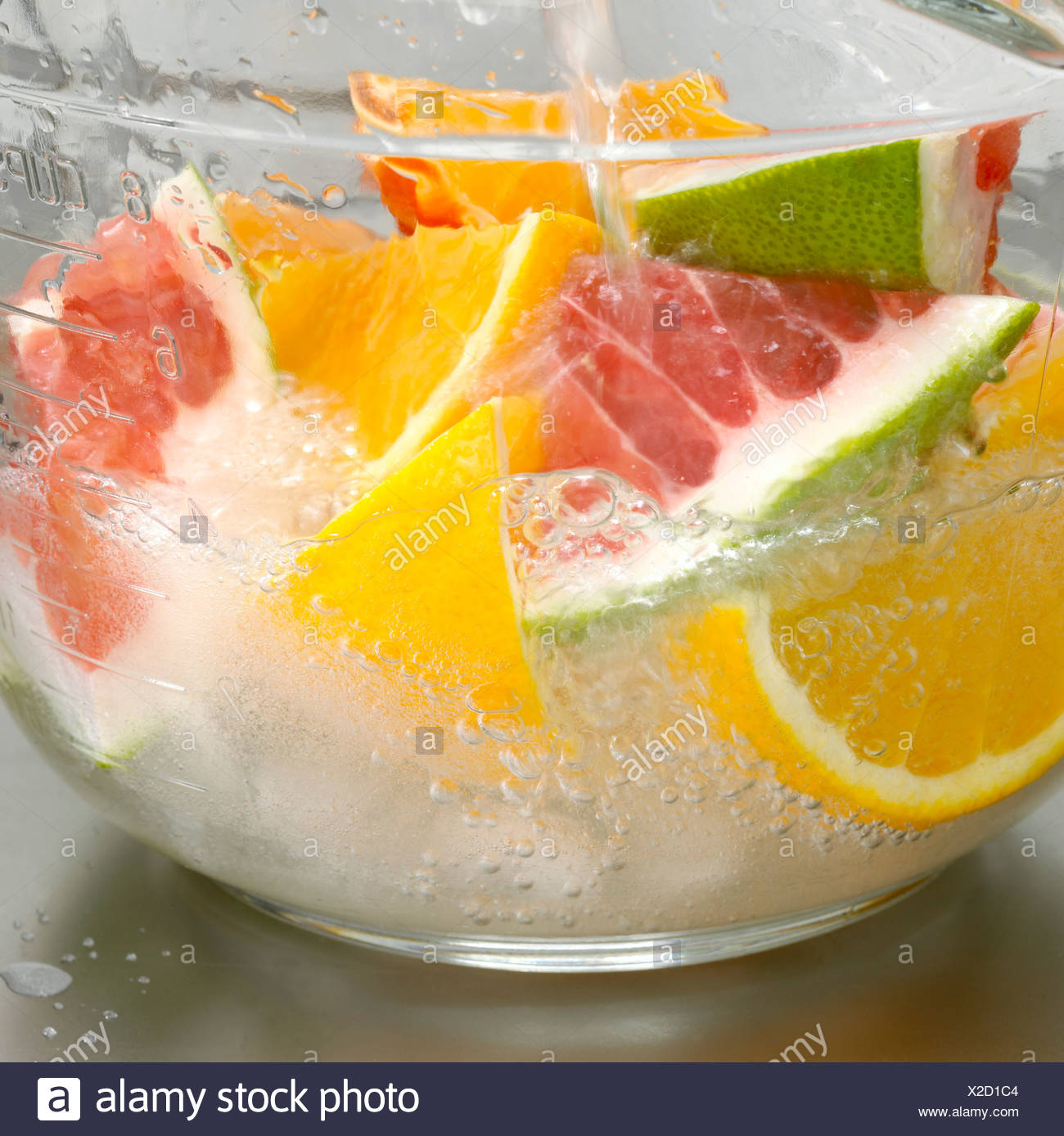 Sliced fruits in bowl, close-up - Stock Image