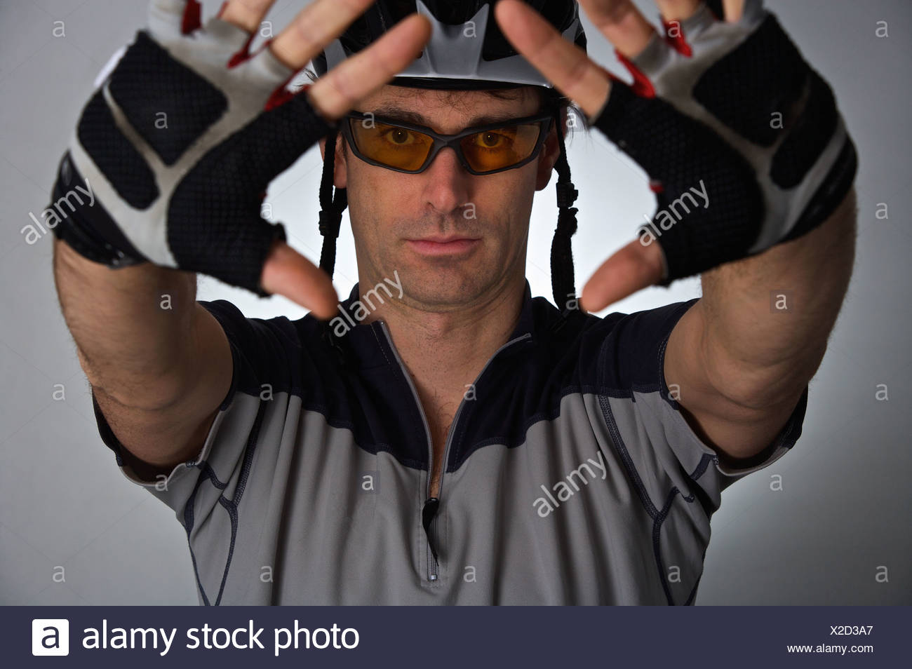 Bicyclist wearing helmet and gloves - Stock Image
