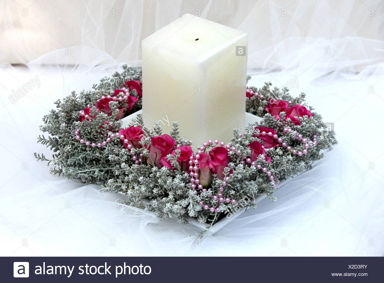Flower Arrangement with candle on white - Stock Image