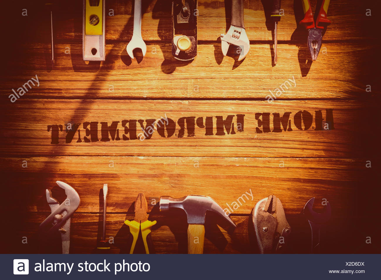 Home improvement against desk with tools - Stock Image