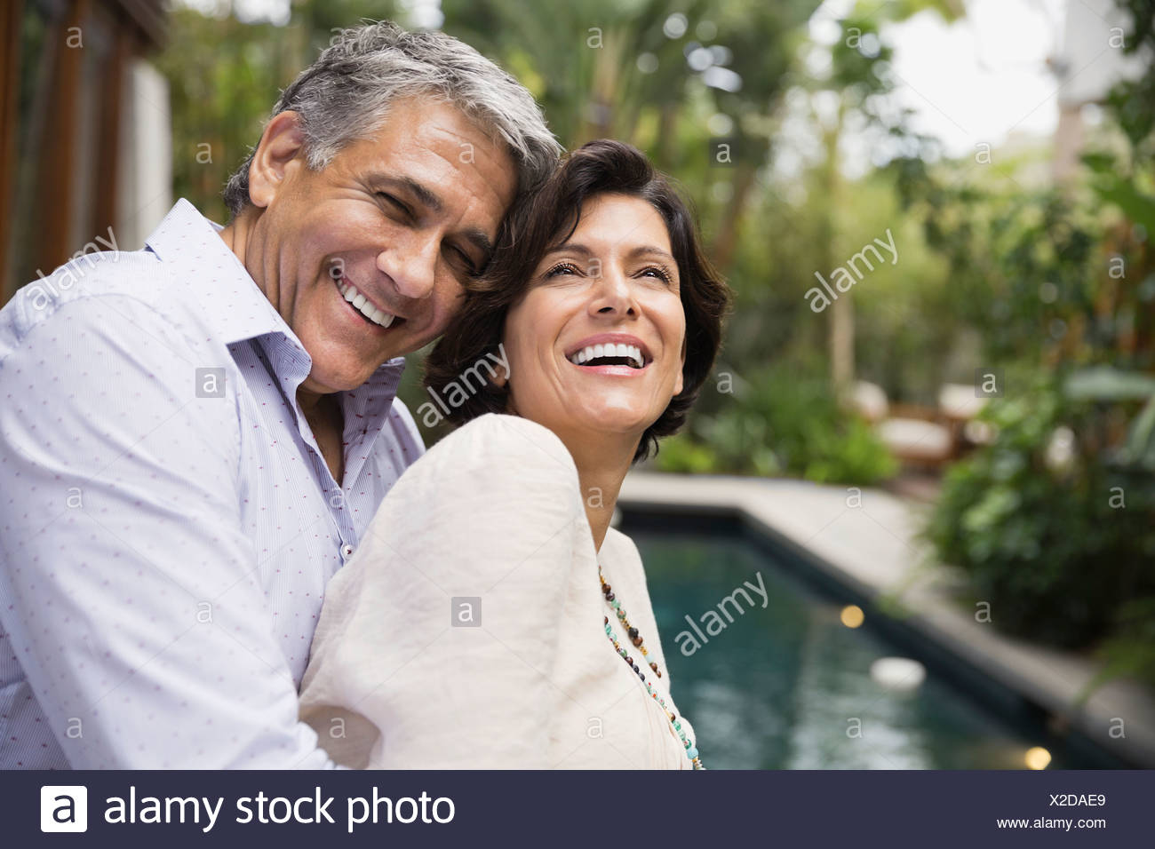 Mature couple embracing outdoors - Stock Image