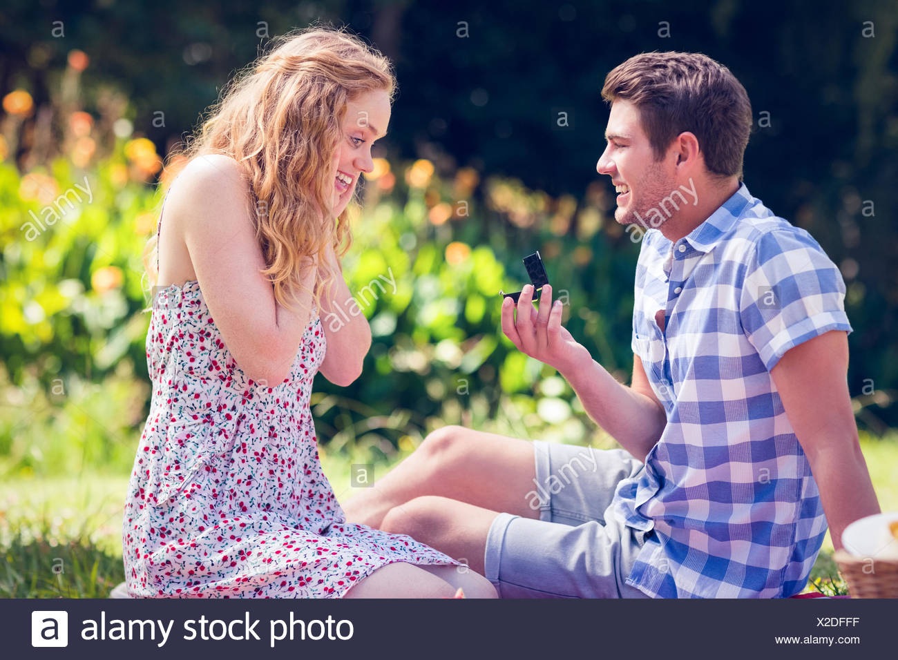 Handsome man doing marriage proposal to his girlfriend Stock Photo