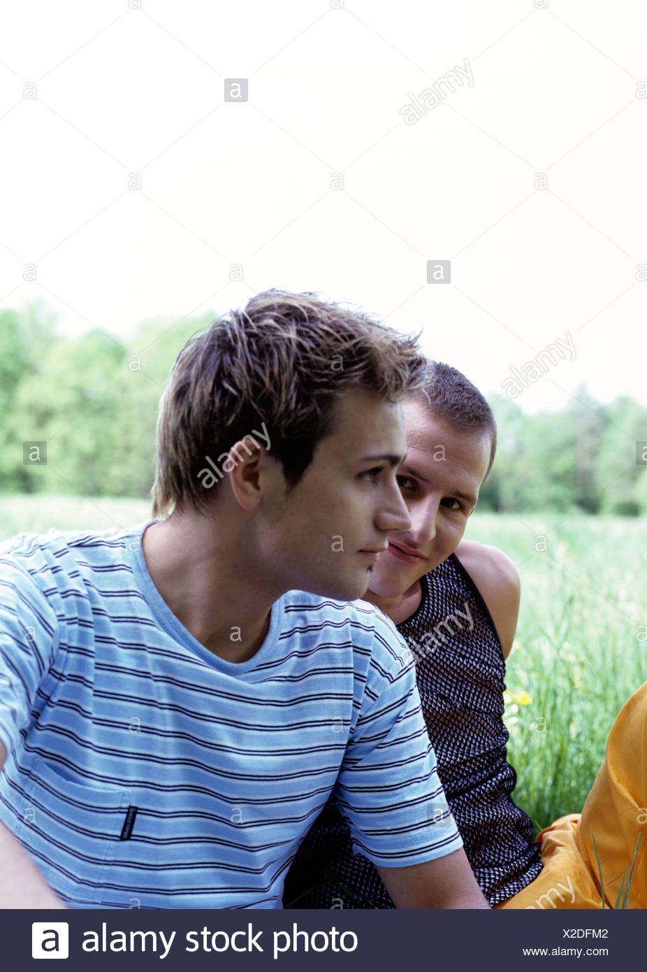 gay couple enjoying an afternoon in the park - Stock Image