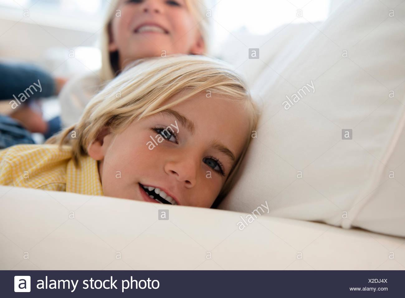 Boy (4-5) and girl (6-7) looking at camera - Stock Image