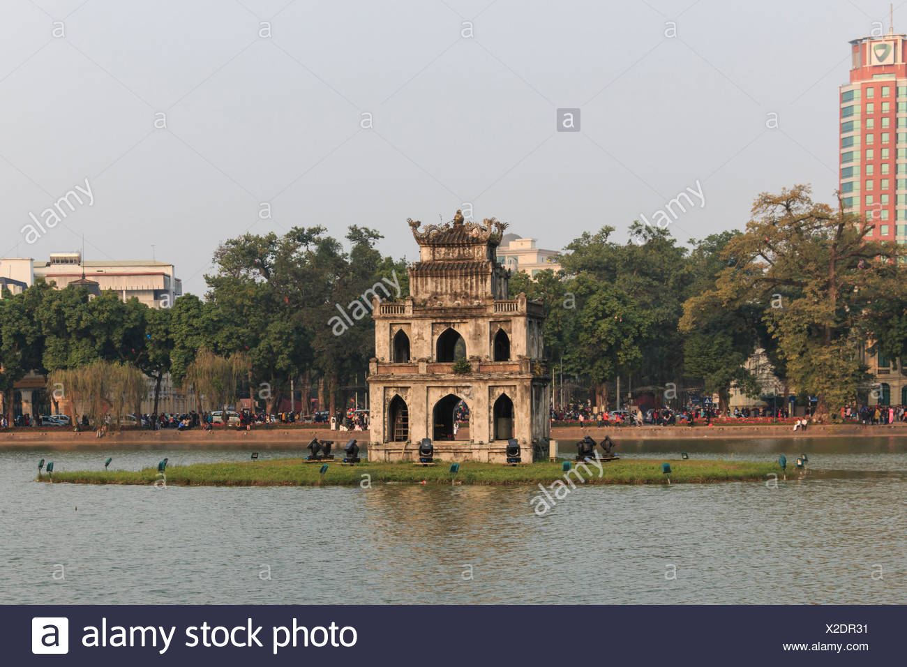 Sunset view of the Hoan Kiem Lake (Lake of the Returned Sword) and the Turtle Tower - Stock Image