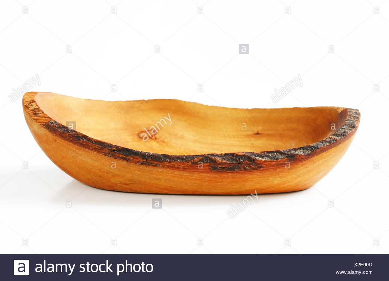 Olive wood boat-shaped rustic bowl Stock Photo