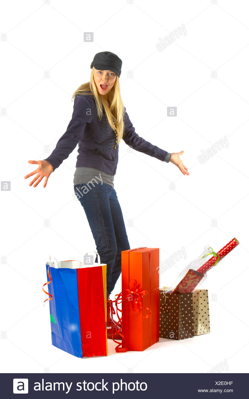 Shocked young woman with shopping bags against white background Stock Photo