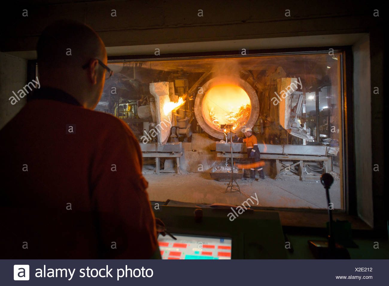 Monitoring furnace at aluminum recycling plant - Stock Image