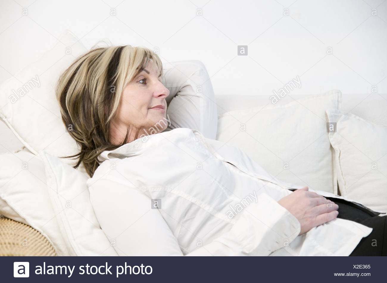 unwell on the sofa - Stock Image