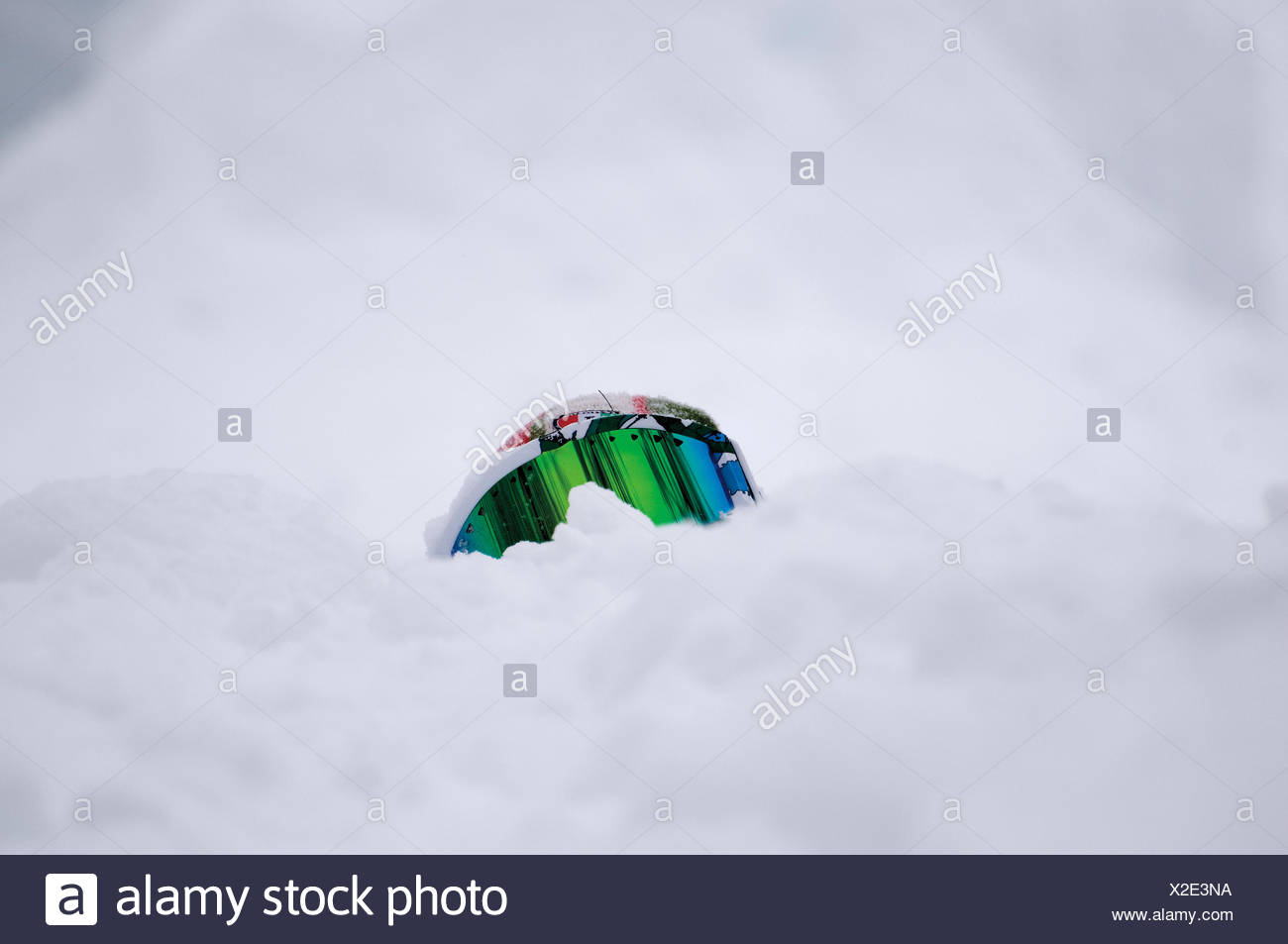 Close-Up Of Ski Goggles On Snow Covered Field - Stock Image