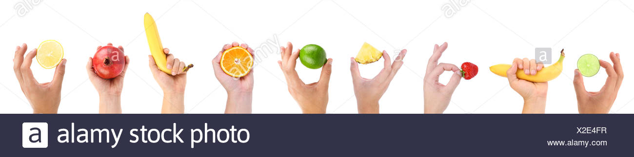 EXCELLENCE. Hands hold fruit and berry. - Stock Image