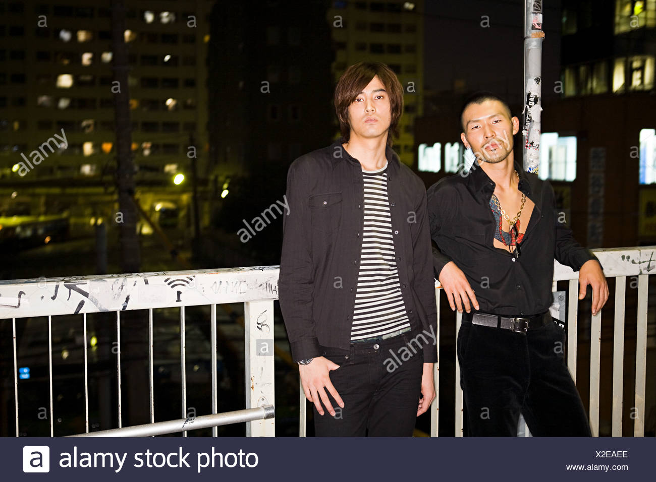 Two japanese men against urban backdrop - Stock Image