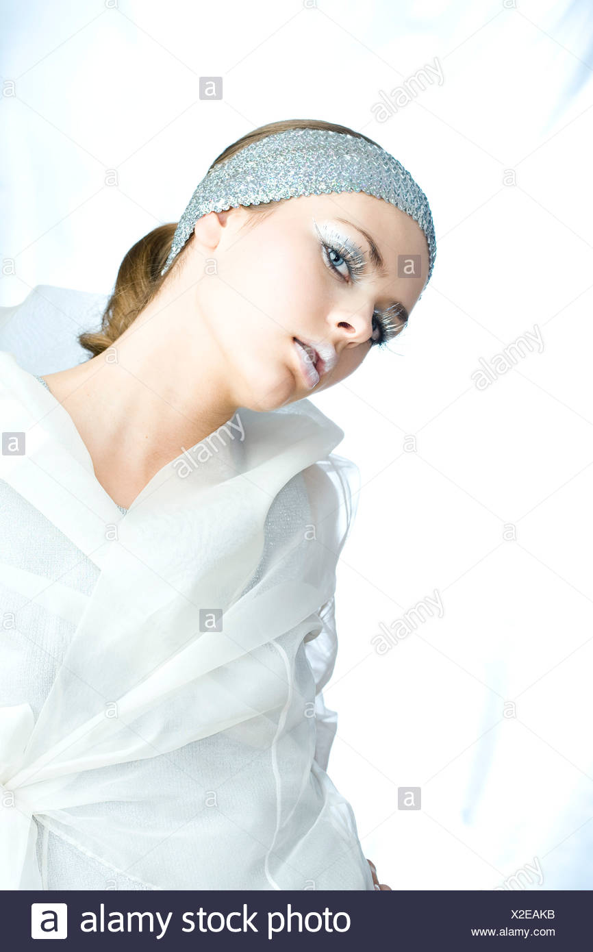 Young woman with silver make up - Stock Image