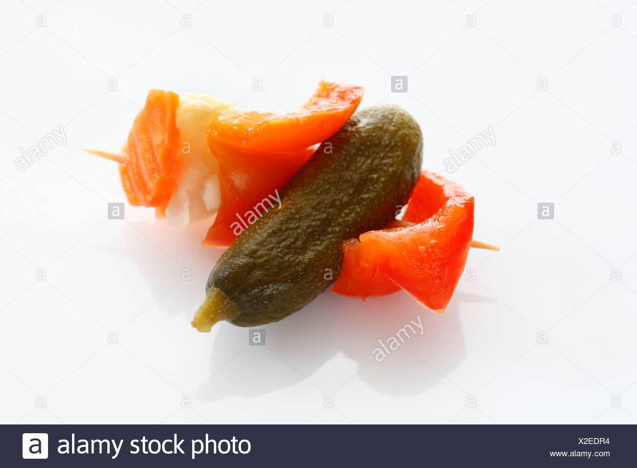 Preserved mixed pickles in skewer, close up - Stock Image