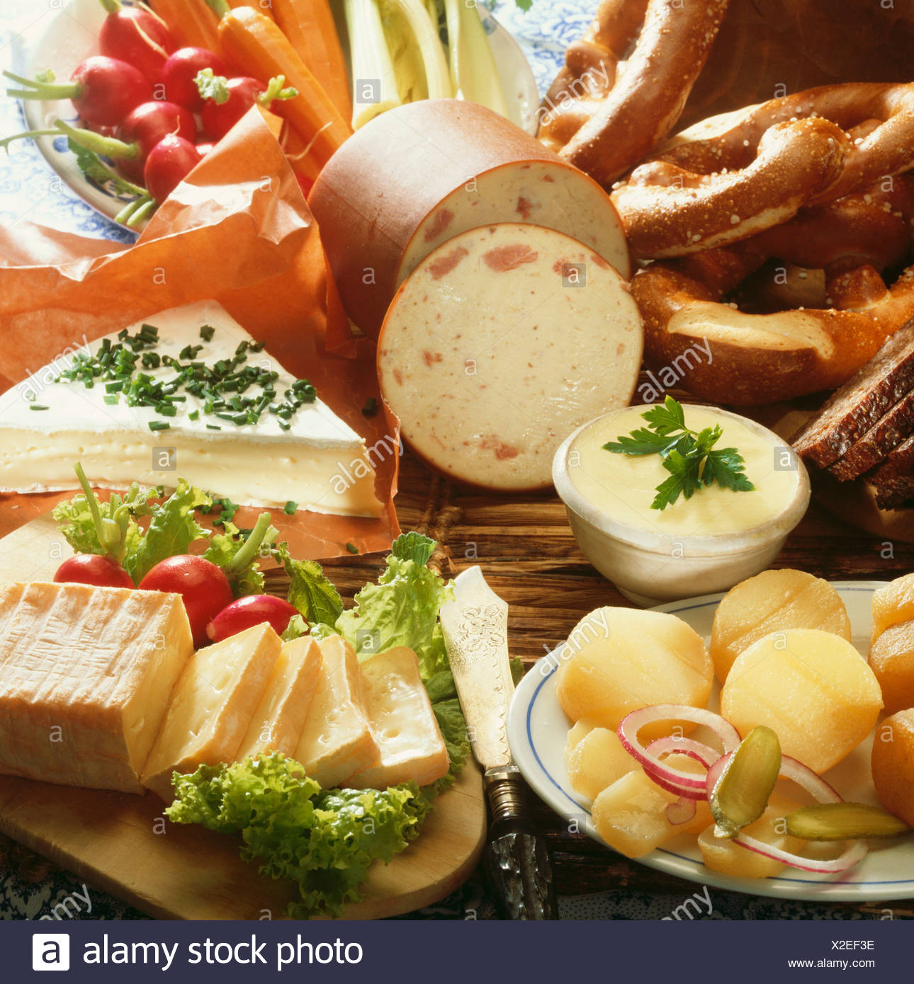Platter of cheese and sausages for hearty snack - Stock Image