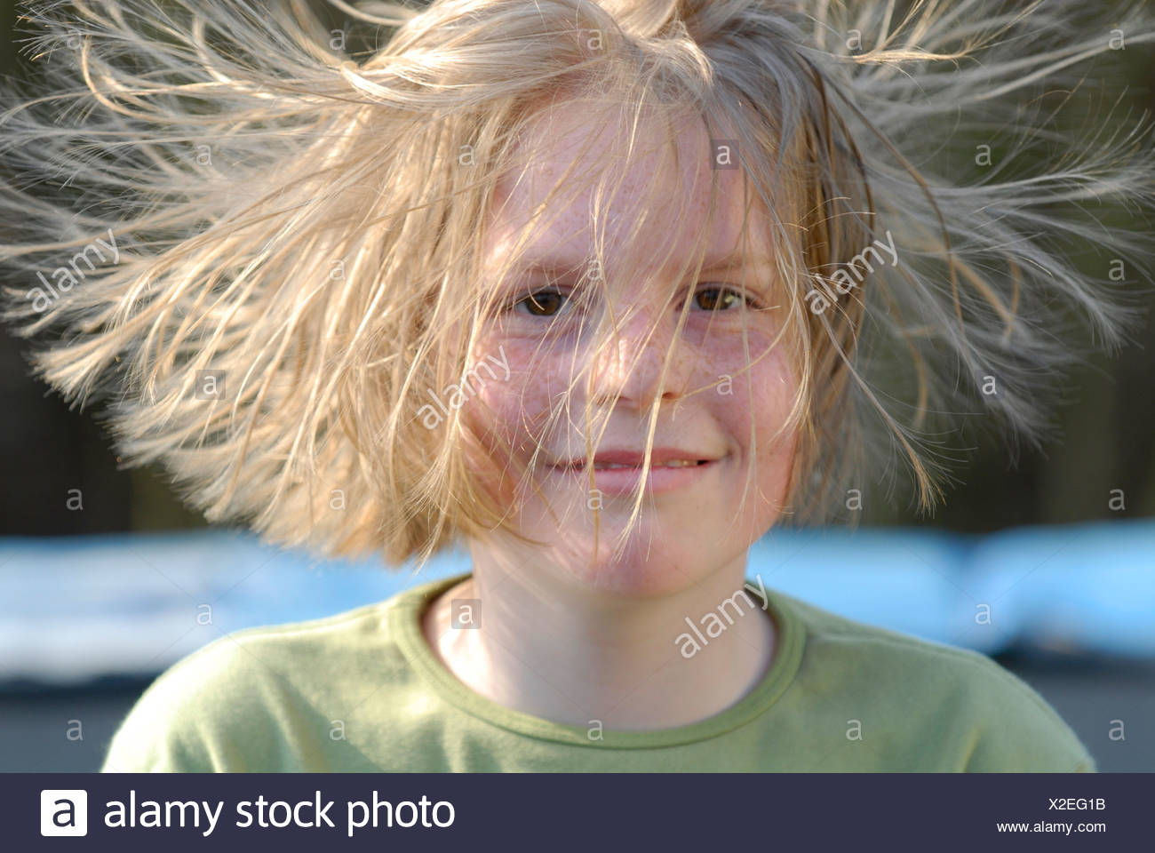 Girl with electrostaticly charged hair - Stock Image