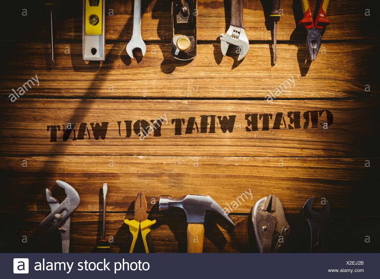 Create what you want against desk with tools - Stock Image