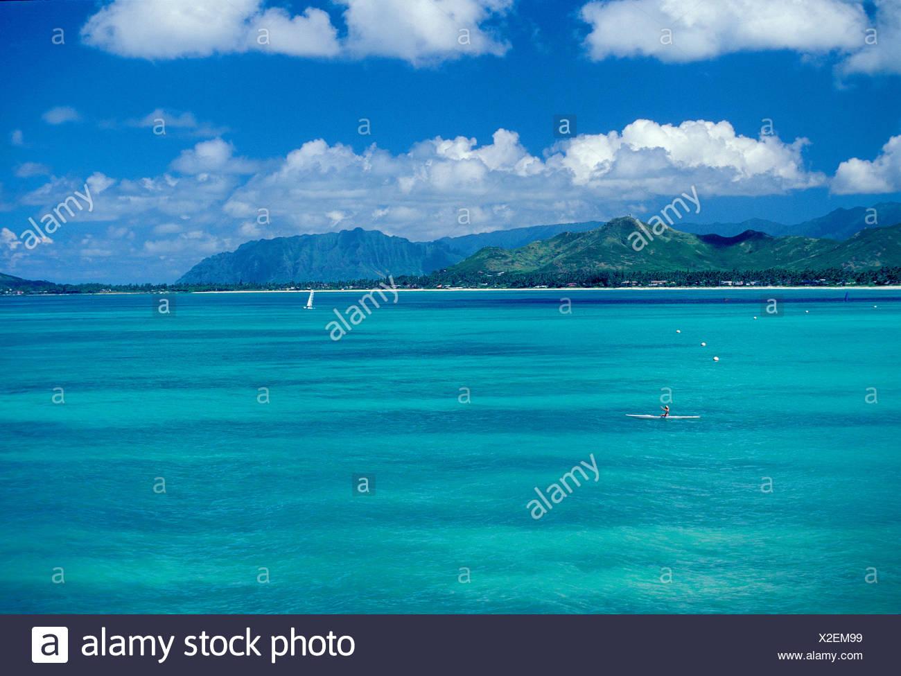 Kayaking on bluegreen waters near Kailua and Lanikai. Windward side, Oahu - Stock Image