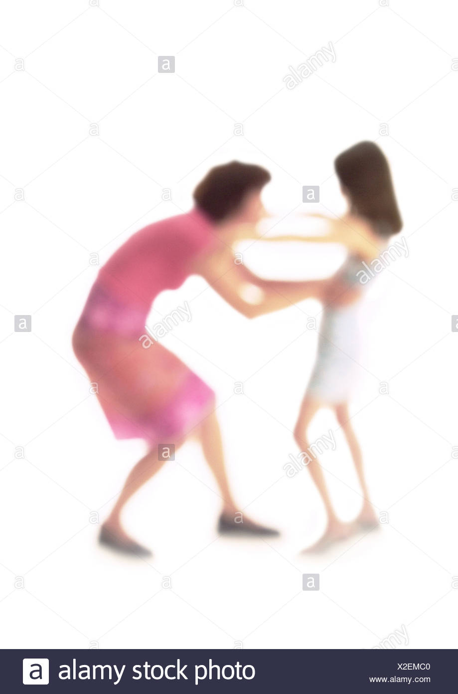 Silhouette of mother and daughter about to hug, on white background, defocused - Stock Image