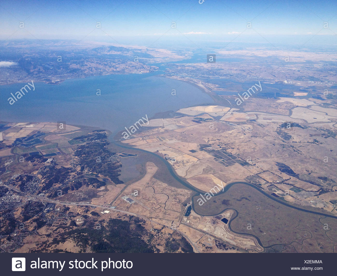 USA, California, Agricultural land and lake - Stock Image
