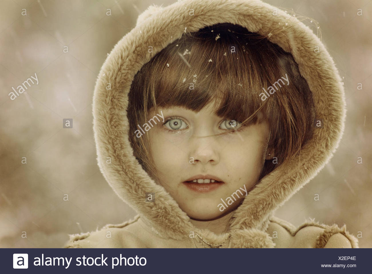 Portrait of girl wearing fur hood - Stock Image