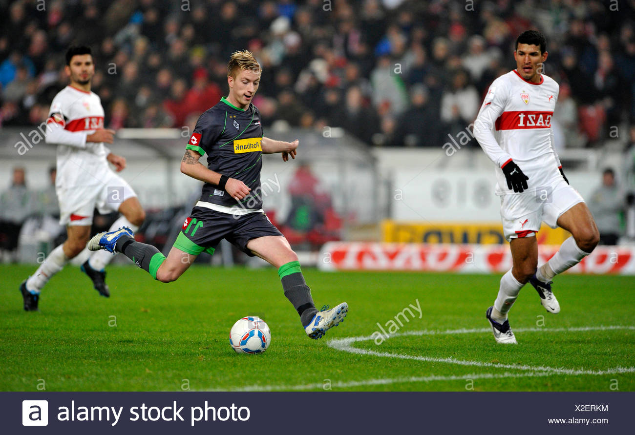 Marco Reus from Borussia Moenchengladbach shooting the goal for the score of 0:2, in front of Maza, VfB Stuttgart, left - Stock Image