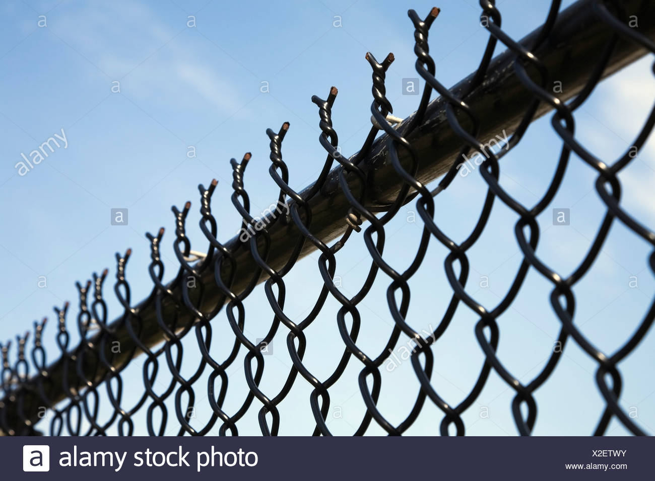 Barb wire security fence - Stock Image