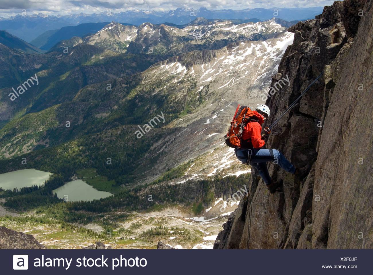 Male alpine rock climber steep cliff Kane Peak - Stock Image