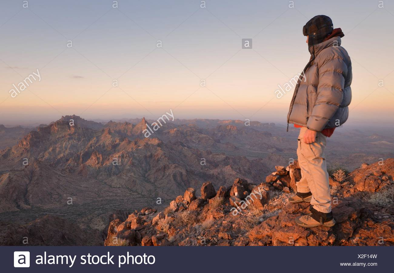 Mature man standing on the summit of Castle Dome, Arizona, USA - Stock Image